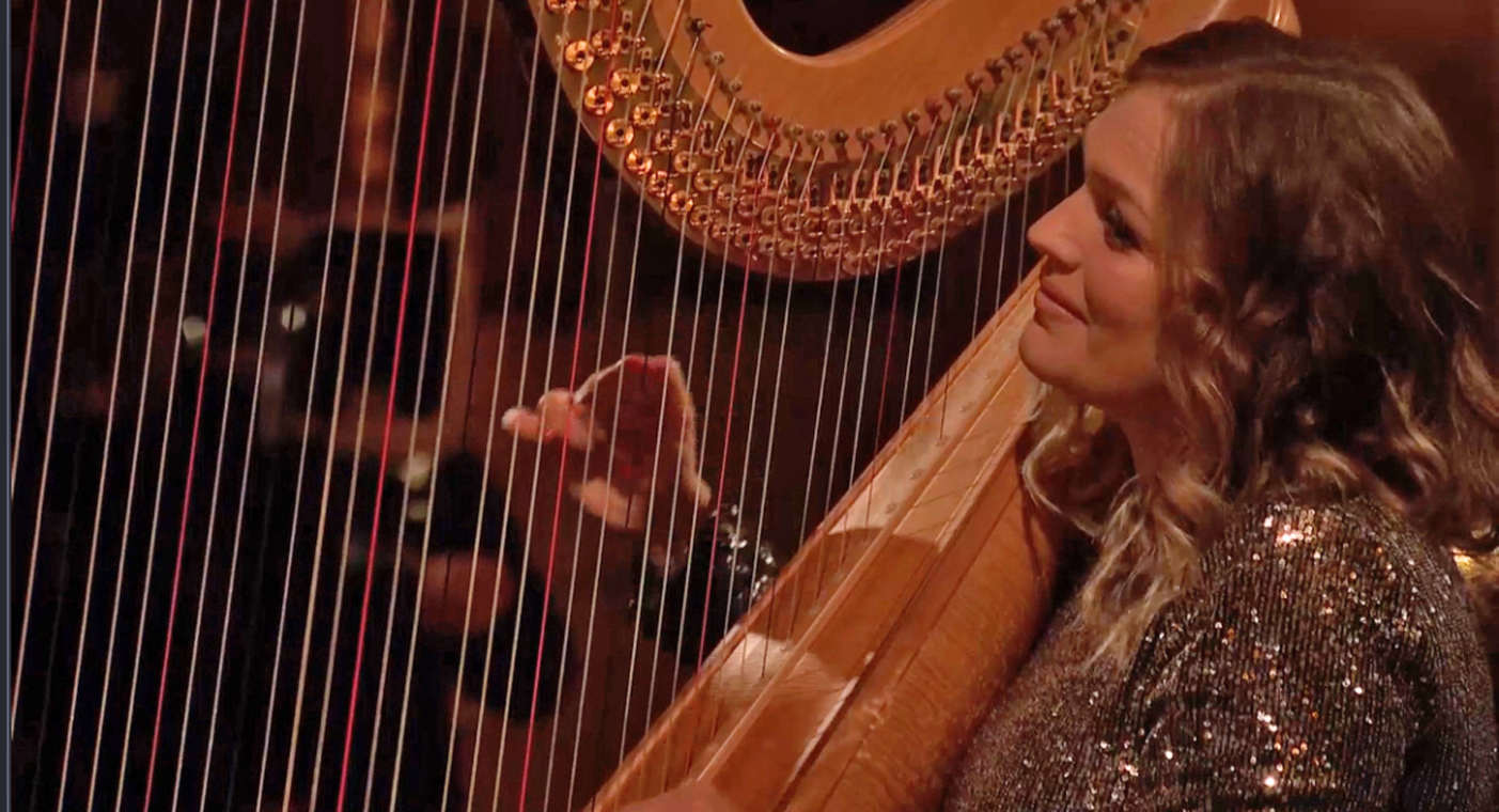 Harpist Hannah Stone playing at Brecon Cathedral for The Metropolitan Opera